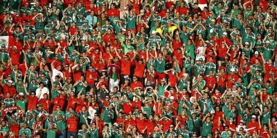 Fans of Mexico cheer during their 2014 World Cup Group A soccer match against Brazil at the Castelao arena in Fortaleza June 17, 2014. REUTERS/Mike Blake  (BRAZIL  - Tags: SOCCER SPORT WORLD CUP)   - RTR3UB9Q